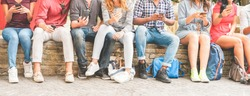 Happy millennials friends surfing online with mobile phones - Young people using smartphone outdoor - Youth lifestyle, generation z and technology trend concept - Focus on hands mobiles