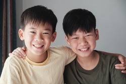 Happy mixed race Asian tween preteen teen boys smiling and hugging each other, , friendships, international children's day, Best Friends Forever, youth day concept