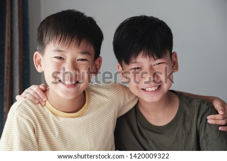 Happy mixed race Asian tween preteen teen boys smiling and hugging each other, , friendships, international children's day, Best Friends Forever, youth day concept Stock foto ©
