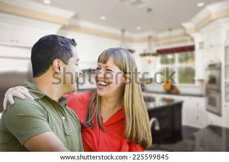 Happy Mixed Race Couple Inside Beautiful Custom Kitchen