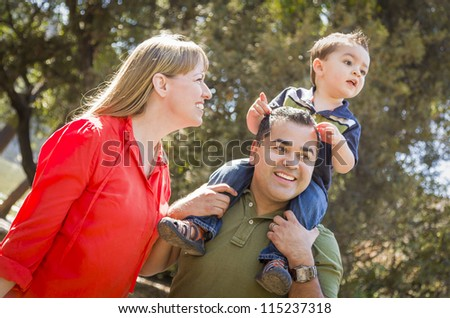 Happy Mixed Race Family with Enjoy a Walk in the Park.