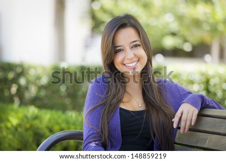 Happy Mixed Race Female Student Portrait on School Campus Bench.