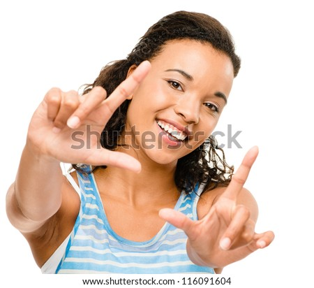 Happy mixed race woman framing photograph isolated on white background
