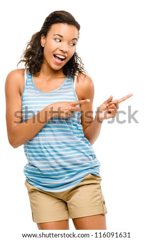 Happy mixed race woman pointing empty copy space isolated on white background