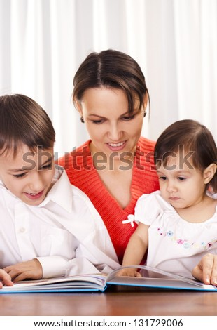 happy mom spend time with her young children