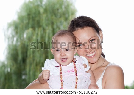 happy mom with a newborn for a walk