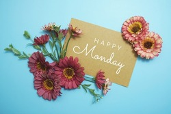 Happy Monday card typography text with flower bouquet on blue background