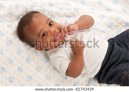 happy 6-month old African American baby boy portrait