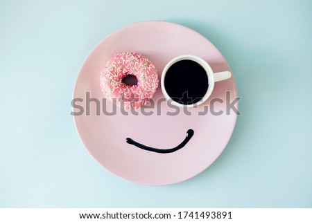 Happy morning! Donut and coffee on a plate. Funny face Foto d'archivio ©