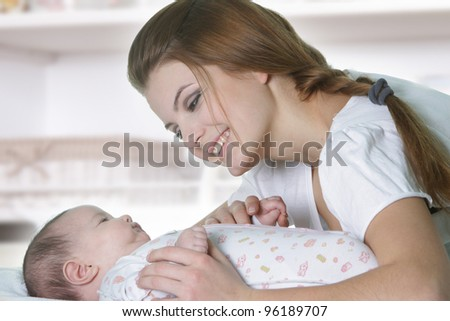 happy mother and baby at home - stock photo