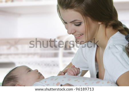 happy mother and baby at home