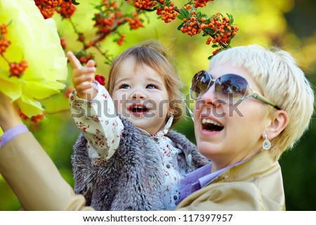 happy mother and baby in autumn park