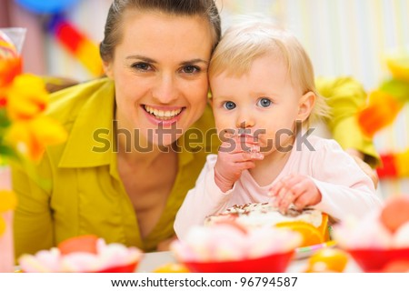 Happy mother and baby on first birthday celebration party