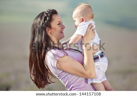 happy mother and baby on nature