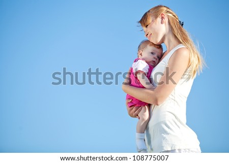 happy mother and baby playing