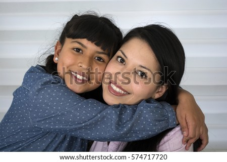 Happy mother and daughter laughing.