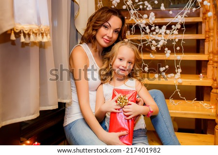 happy mother and daughter near a Christmas tree. Christmas holidays. Christmas decor. new year