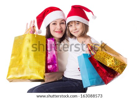 Happy mother and daughter on Christmas shopping isolated on white