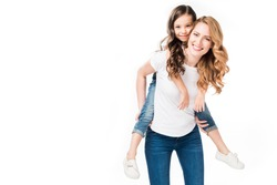 happy mother and daughter piggybacking together isolated on white