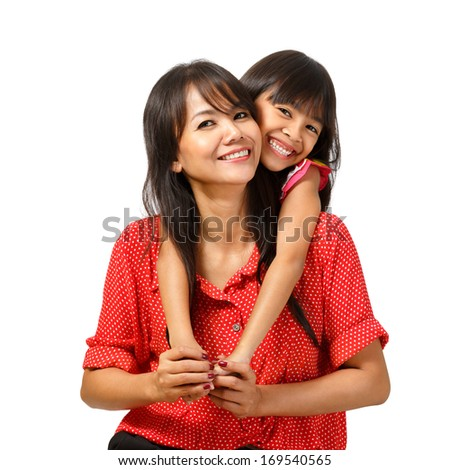 Happy mother and daughter sitting Isolated over white