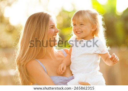 Happy mother and daughter smiling #265862315