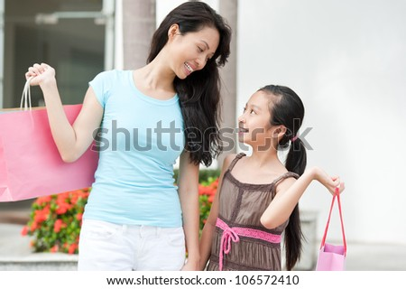 Happy mother and daughter spending time together while shopping
