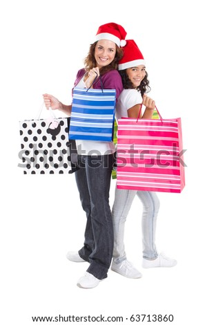 happy mother and daughter with Christmas shopping bags