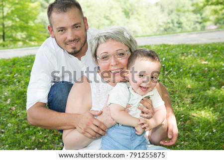 happy mother and father hugging his little son in park #791255875