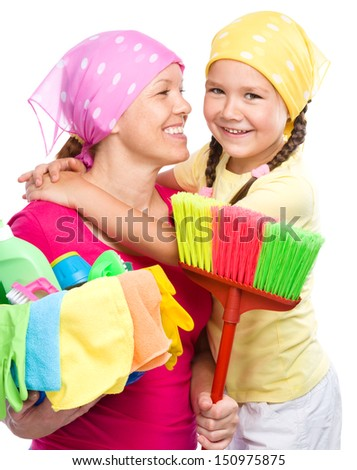 Happy mother and her daughter are dressed for cleaning, isolated over white