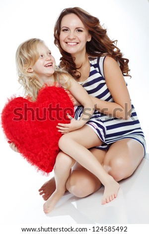 happy mother and her daughter  with big red hearts, isolated against white background
