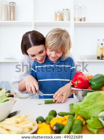 Happy mother and her son cooking at home