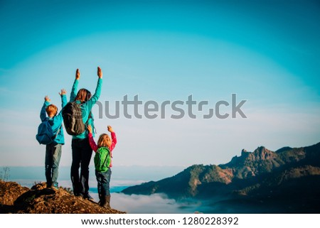 happy mother and kids enjoy travel hiking in mountains #1280228392