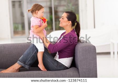 happy mother and little daughter at home