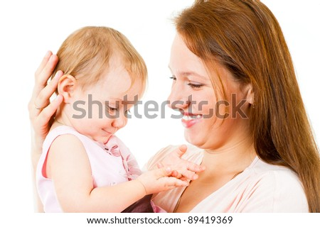 Happy mother and little daughter having fun isolated over white background