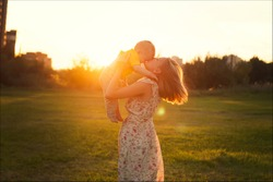 happy mother and son at sunset sunlight