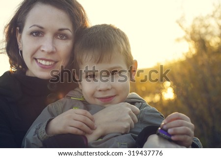 Happy mother and son during fall time  #319437776