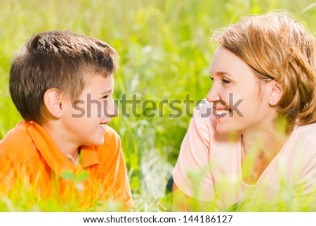 Happy mother and son in park outdoor portrait