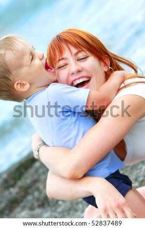 happy mother and son on beach