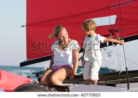 happy mother and son on sea yacht background - stock photo
