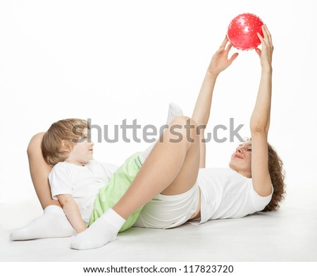 Happy mother doing sport exercises with little daughter