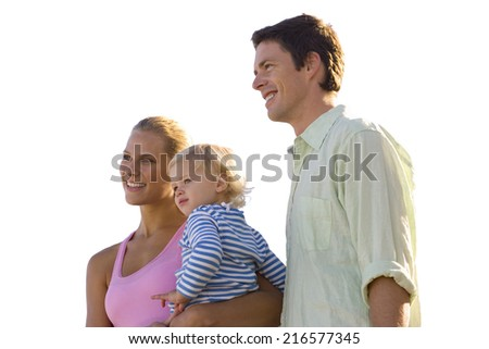 Happy mother, father and daughter smiling