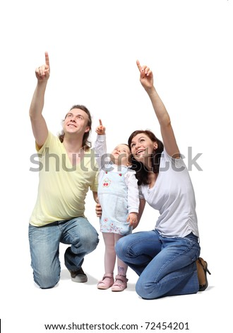 Happy mother, father and little daughter sit down and point fingers up - stock photo