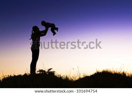 Happy Mother happily raising their children.