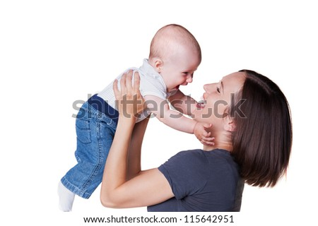 happy mother holding smiley six month old baby and laughing. studio shot over white background