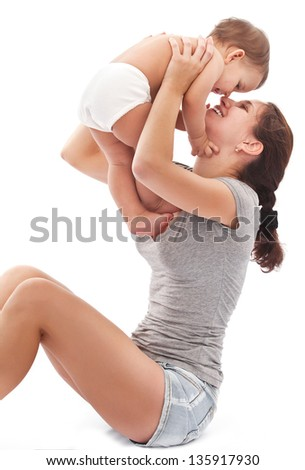 Happy mother plays with baby. Isolated on a white background.