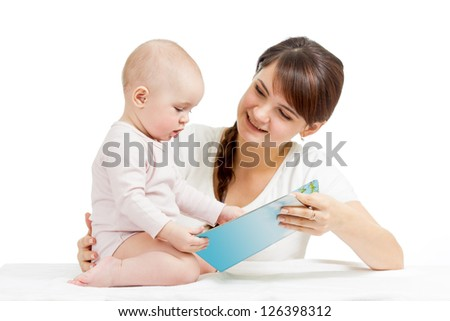 happy mother reading a book to child - stock photo