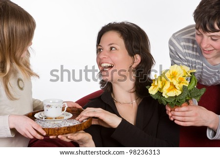Happy mother receiving coffee and flowers on mother's day