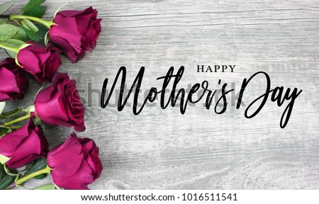 Happy Mother's Day Calligraphy with Pink Roses Over Rustic Wood Background #1016511541
