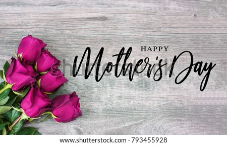 Happy Mother's Day Calligraphy with Pink Roses Over Rustic Wood Background #793455928