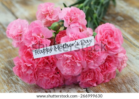 Happy Mother\'s day card with pink carnations bouquet